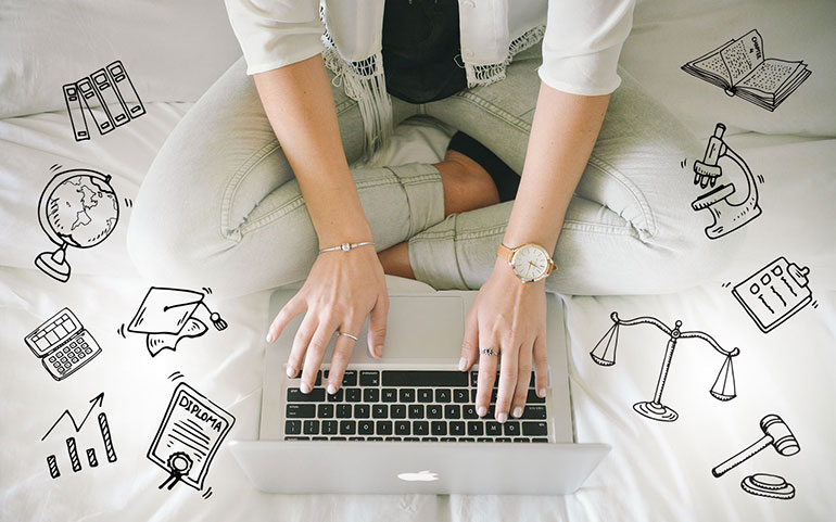 Photograph/Illustration of a person sitting cross legged in front of a laptop with drawings around them for the blog post, 'Challenges and Choices: The Transition Out of Grade Twelve'