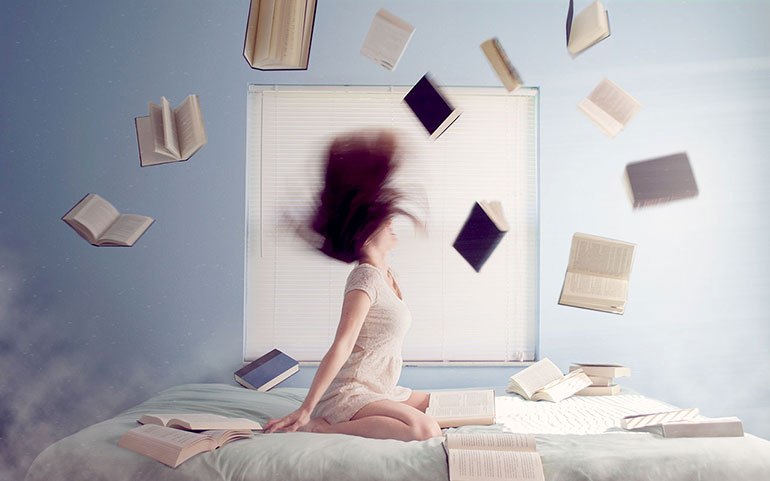Photograph of a blurred person with books falling around them for Life As an 8th Grader and What I Learned From It
