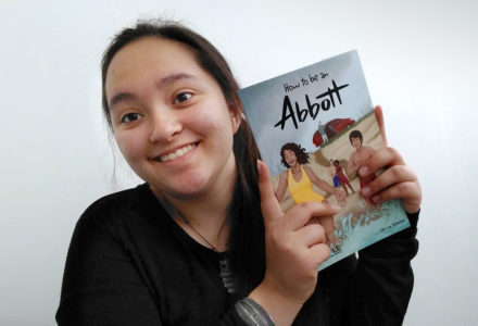 Photograph of Olivia Simms with her book, 'How to be an Abbott' for An Open Letter from Last Year's Kids Write 4 Kids Winner
