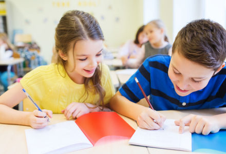 Photograph of 2 kids doing their work for Why Writing is Vital to Your Child's Education