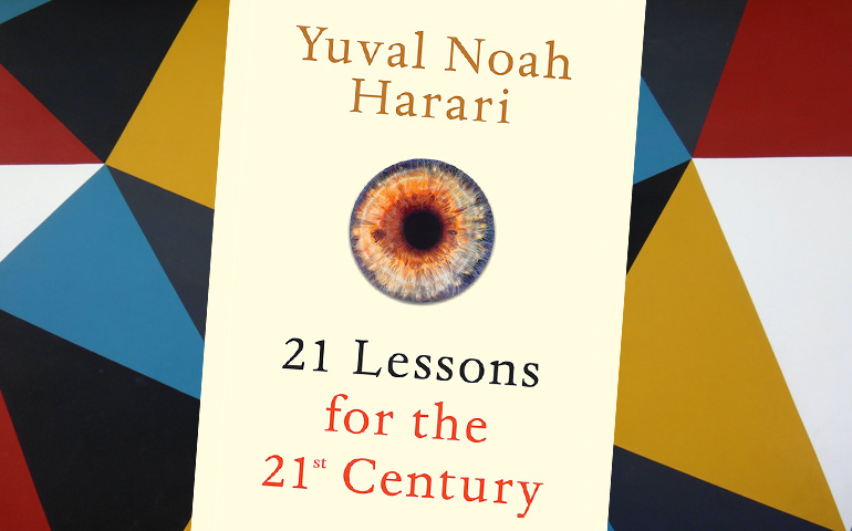 The cover of Yuval Noah Harari's 21 Lessons for the 21st Century sits on a digital background that features many different coloured triangles.