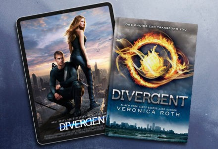 """A tablet shows the movie poster for the film """"Divergent."""" The poster features a woman looking over her shoulder and a man crouching beside her. To the right of the tablet is the cover of the novel """"Divergent"""" by Veronica Roth, which features a city skyline and a burning insignia."""
