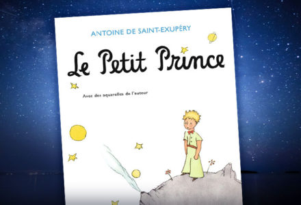 The cover of Antoine de Saint-Exupéry's Le Petit Prince, which features a small boy wearing a crown, is featured against a starry background.