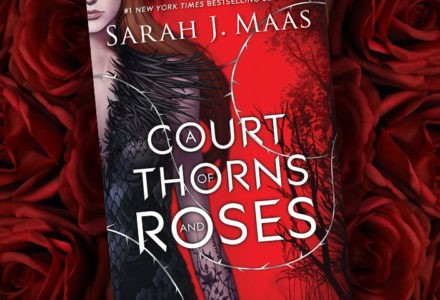 The cover of Sarah J. Maas' A Court of Thorns and Roses is shown, featuring the shoulder of a woman in a black dress. The background features layered roses.