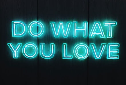 """A neon sign states """"Do what you love"""" in capital letters."""