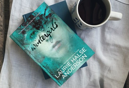 Laurie Halse Anderson's novel Wintergirls is shown next to a mug.